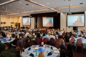 Participants in Key Spouse Kick-Off lunch and learn watch Key Spouse stories on Oct. 2, 2019, at Yokota Air Base, Japan