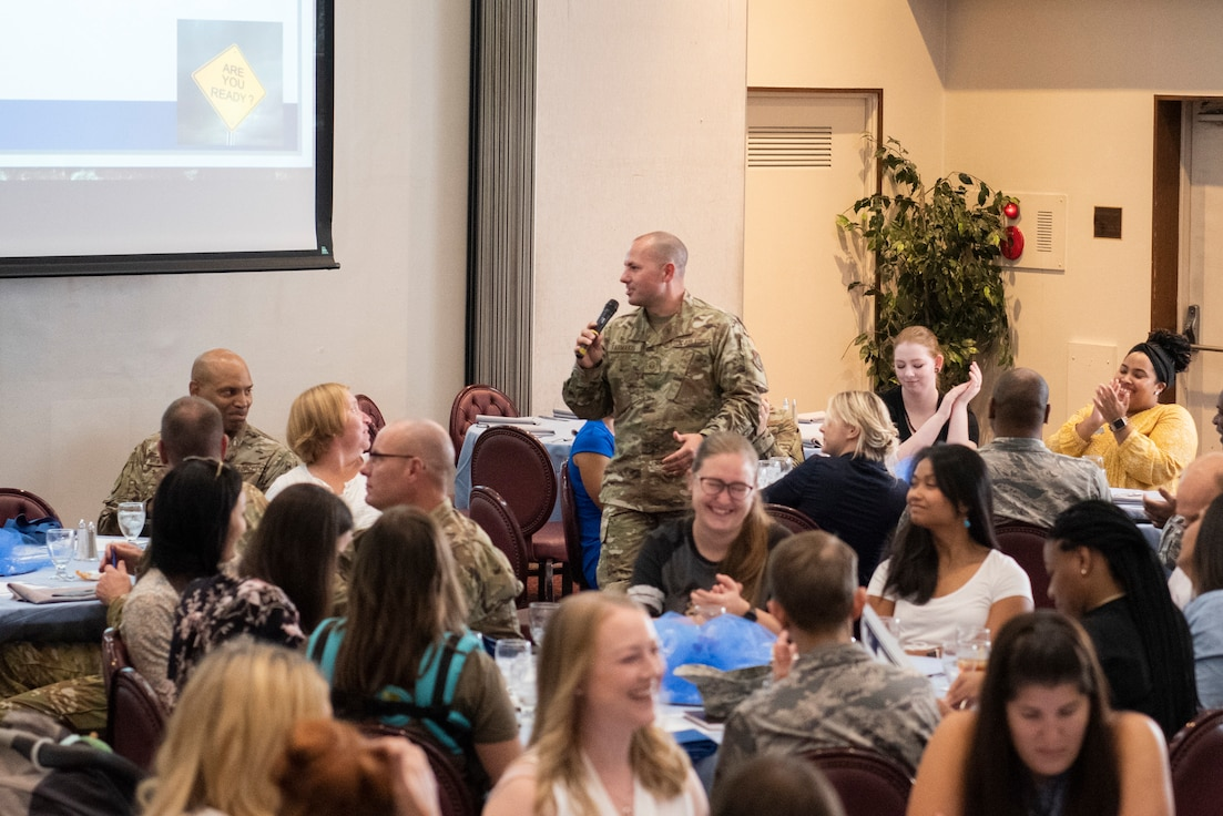 Participants in Key Spouse Kick-Off lunch and learn discuss various scenarios in groups on Oct. 2, 2019, at Yokota Air Base, Japan.