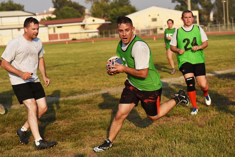 U.S. Air Force Staff Sgt. Spencer Johnson, 39th Security Forces Squadron non-commissioned officer in charge of electronic security systems, runs with the ball during a rugby game Sept. 14, 2019, at Incirlik Air Base, Turkey. Although the sport is popular in most former British colonies, rugby's presence in the U.S. is overshadowed by its offspring, American football. (U.S. Air Force Photo by Staff Sgt. Joshua Magbanua)