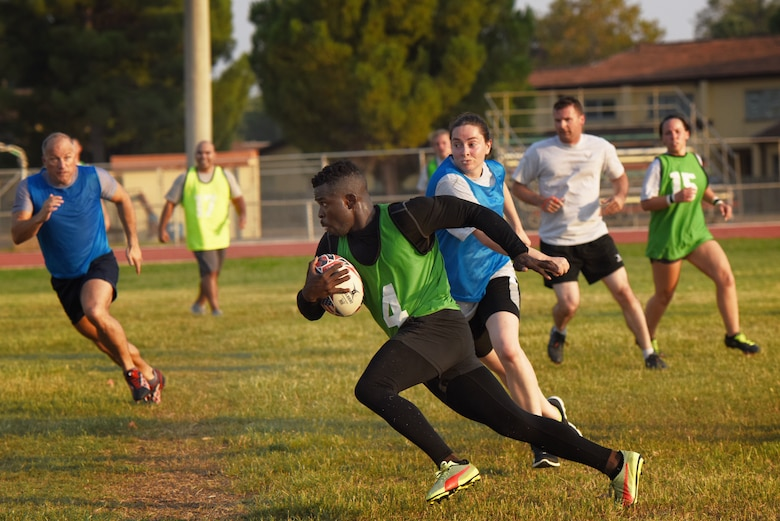 U.S. Air Force Staff Sgt. Osasumwen Edomwandagbon, 39th Medical Operations Squadron mental health supervisor, runs with the ball during a rugby game Sept. 14, 2019, at Incirlik Air Base, Turkey. Rugby enthusiast at Incirlik recently formed a league which they hope will become a permanent presence on the installation. (U.S. Air Force Photo by Staff Sgt. Joshua Magbanua)