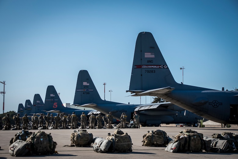 Soldiers assigned to the U.S. Army's 173rd Infantry Airborne Brigade prepare to board a C-130H Hercules, assigned to the 179th Airlift Wing, Ohio Air National Guard, for an air drop during Saber Junction 2019 (SJ19) September 18, 2019, at Ramstein Air Base, Germany. SJ19, an exercise involving nearly 5,400 participants from 16 ally and partner nations and the U.S. Army's Grafenwoehr and Hohenfels Training Areas, is designed to assess the readiness of the U.S. Army's 173rd Infantry Airborne Brigade to execute land operations in a joint, combined environment and to promote interoperability with participating allies and partner nations. (U.S. Air National Guard photo by Airman 1st Class Alexis Wade)