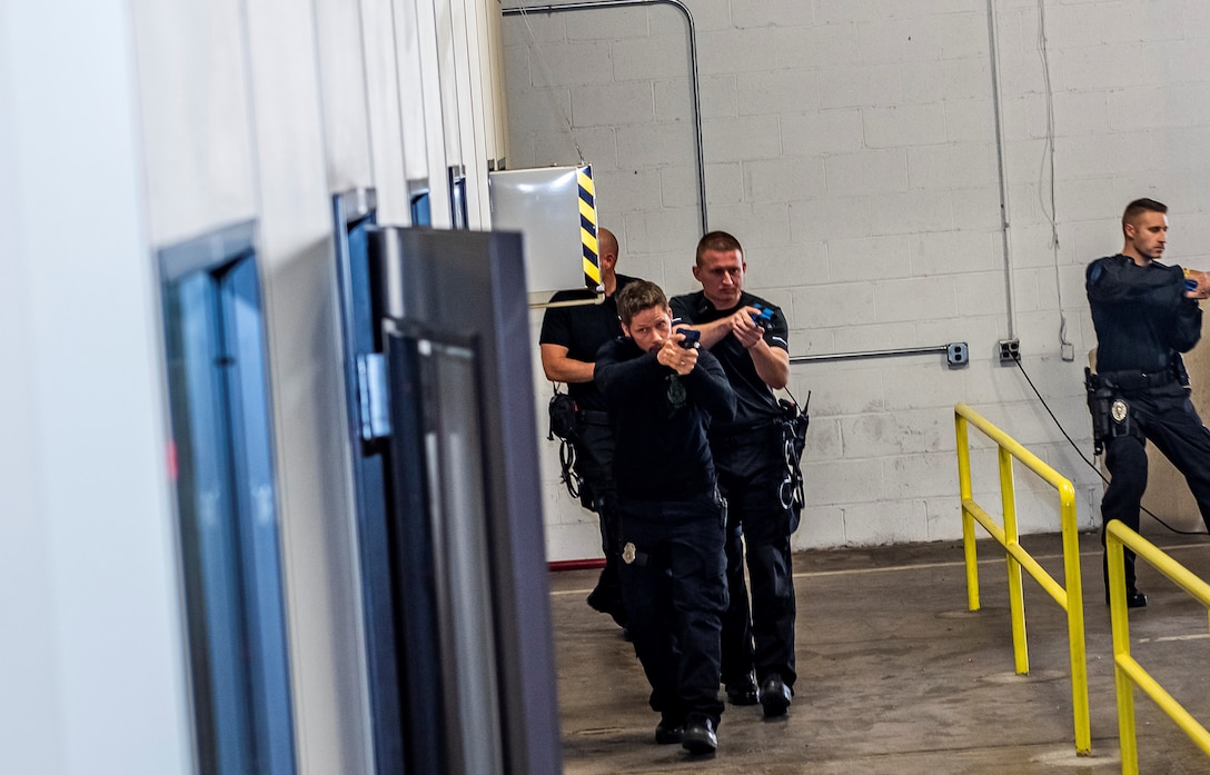 Law enforcement officers conduct operation exercise.