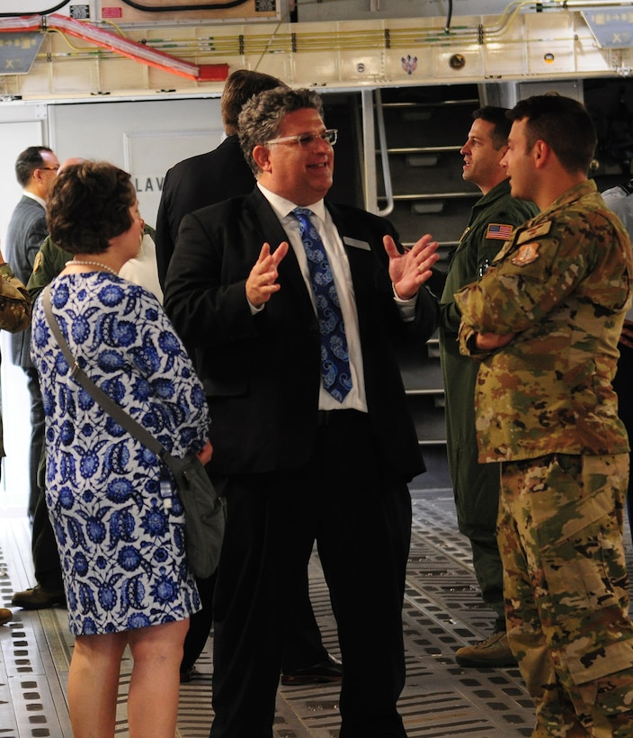 Paul Schlottman, Director of Strategic Initiatives at the University of Dayton and honorary commander for the 445th Force Support Squadron, talks to Staff Sgt. Cody Green, 89th Airlift Squadron loadmaster, during a C-17 Globemaster III tour Sept. 6, 2019. Eighteen members from the surrounding communities were officially designated as honorary commanders in an official ceremony.