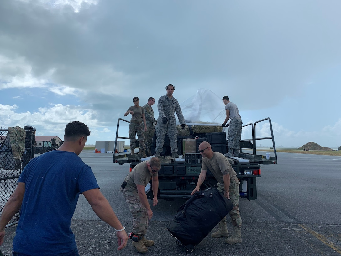 Reserve Citizen Airmen from the 920th Rescue Wing load bags.