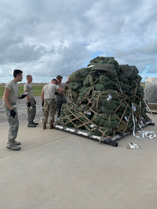 Reserve Citizen Airmen from the 920th Rescue Wing load an aircraft pallet