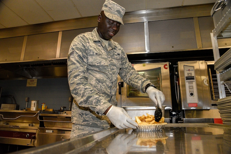 Airman 1st Class Ousseynou Mbaye, a base support specialist assigned to the 175th Force Support Squadron, prepares a pie for an event supported by the base services program, July 3, 2019 at Martin State Airport, Middle River, Md. Mbaye chose this career field because of his previous experience in the restaurant industry.