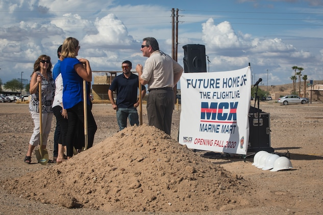 Col. David A. Suggs, the commanding officer of Marine Corps Air Station (MCAS) Yuma, John Courtis, MCAS Yuma's Auxiliary Commander and Executive Director of the Yuma County Chamber of Commerce, and other Yuma County Chamber of Commerce ambassadors shovel the first soil during the groundbreaking ceremony for the Flightline Marine Mart on MCAS Yuma, Ariz., Sept. 26, 2019. The Chamber of Commerce serves as the business voice of Yuma, advocating for both local businesses and local residents of Yuma. The new Marine Mart, set to open in 2020, will contain a barber shop, MCX shopping center, and will have a drive-thru. (U.S. Marine Corps photo by Sgt. Isaac D. Martinez)