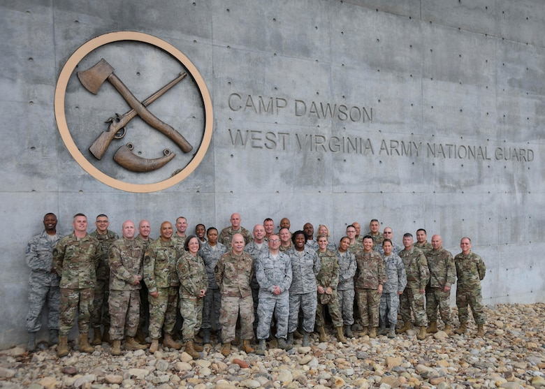 """Approximately 30 U.S. Air force chief caster sergeants, assigned to the Air National Guard Readiness Center, pose for a group photo at Camp Dawson, West Virginia, Sept. 15, 2019. The chiefs traveled to Camp Dawson to participate in a two-day, teambuilding off-site event titled """"Back to the Basics."""" (U.S. Air National Guard photo by Staff Sgt. Morgan R. Lipinski)"""