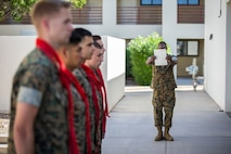 U.S. Marines assigned to Marine Corps Air Station (MCAS) Yuma, Headquarters and Headquarters Squadron (H&HS), recieve their blood stripe during the H&HS Blood Stripe Ceremony at MCAS Yuma, Ariz., Oct 1, 2019. The blood stripe honors the blood that was shed by Marine officers and noncommissioned officers (NCO) during the Battle of Chapultepec in 1847 and is worn on the trousers of NCO's, Staff NCO's, and officers in rememberance of those who courageously fought in the battle. (U.S. Marine Corps photo by Lance Cpl. John Hall)