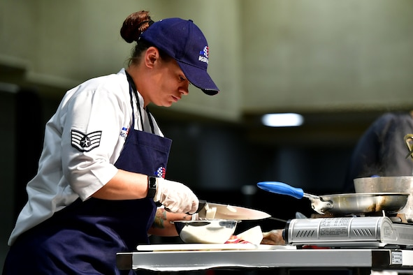An Airman chops onions during the Iron Chef Championship competition