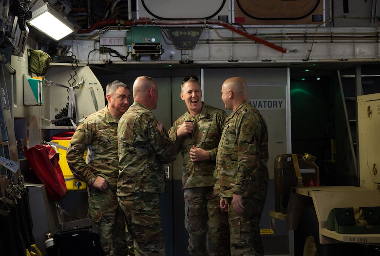 From right, U.S. Air Force Chief Master Sgt. Robert Schultz, 62nd Airlift Wing command chief; U.S. Army Col. Skye Duncan, Joint Base Lewis-McChord (JBLM) commander; U.S. Army Command Sgt. Maj. Timothy Marble, JBLM command sergeant major; and U.S. Air Force Chief Master Sgt. Joel Buys, JBLM senior enlisted leader and 627th Air Base Group command chief, talk onboard a C-17 Globemaster III at JBLM, Wash., Oct. 1, 2019. The purpose of the flight was to provide training opportunities for Soldiers assigned to the 51st Expeditionary Signal Battalion, 35th Signal Brigade, and 7th Airlift Squadron pilots and loadmasters. (U.S. Air Force photo by Senior Airman Tryphena Mayhugh)