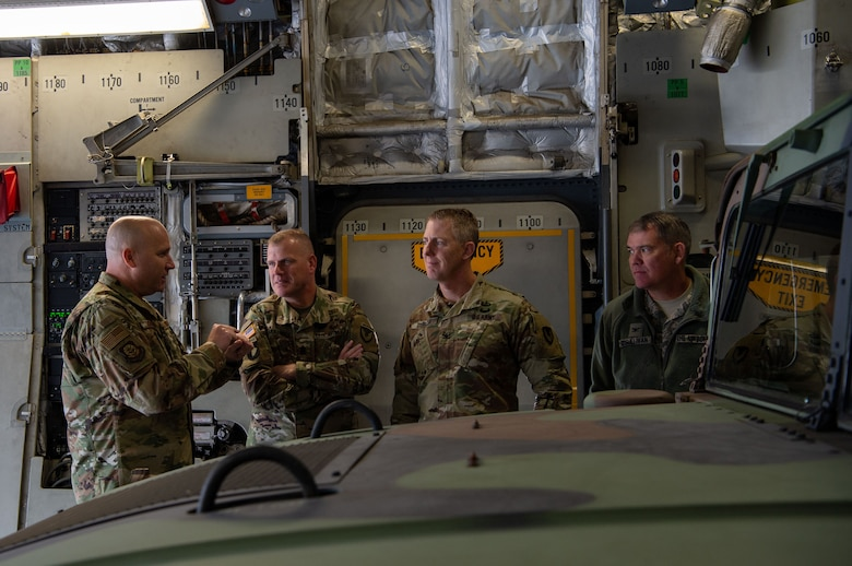 From left, U.S. Air Force Chief Master Sgt. Robert Schultz, 62nd Airlift Wing command chief; U.S. Army Command Sgt. Maj. Timothy Marble, Joint Base Lewis-McChord (JBLM) command sergeant major; U.S. Army Col. Skye Duncan, JBLM commander; and U.S. Air Force Col. Patrick O'Sullivan, JBLM vice commander and 627th Air Base Group commander, witness how U.S. Air Force loadmasters and U.S. Army Soldiers work together to offload Army equipment from a C-17 Globemaster III at Moses Lake Municipal Airport, Wash., Oct. 1, 2019. The purpose of the flight was for Soldiers from the 51st Expeditionary Signal Battalion, 35th Signal Brigade, to test their long-range communication equipment from Moses Lake to JBLM for a mobility movement exercise. (U.S. Air Force photo by Senior Airman Tryphena Mayhugh)