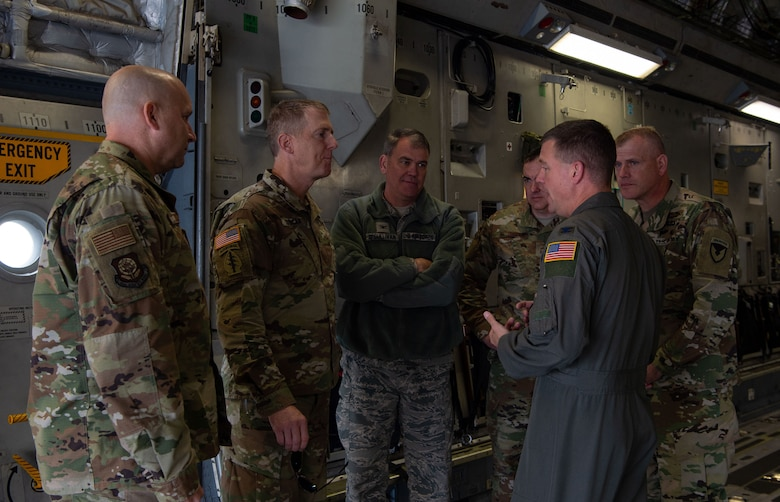 U.S. Air Force Col. Scovill Currin (front right), 62nd Airlift Wing commander, talks to Joint Base Lewis-McChord (JBLM) and Team McChord leaders about interoperability between the Air Force and Army inside a C-17 Globemaster III at Moses Lake Municipal Airport, Wash., Oct. 1, 2019. Soldiers from the 51st Expeditionary Signal Battalion, 35th Signal Brigade, tested their long-range communication equipment from Moses Lake to JBLM for a mobility movement exercise. (U.S. Air Force photo by Senior Airman Tryphena Mayhugh)