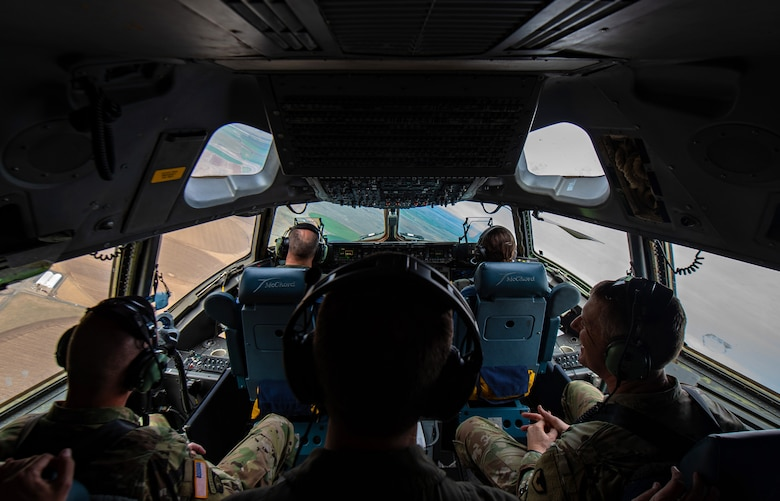 From back right, U.S. Army Col. Skye Duncan, Joint Base Lewis-McChord (JBLM) commander; U.S. Air Force Col. Scovill Currin, 62nd Airlift Wing commander; and U.S. Army Command Sergeant Major Timothy Marble, JBLM command sergeant major, sit in the flight deck of a C-17 Globemaster III near Moses Lake Municipal Airport, Wash., Oct. 1, 2019. The purpose of the flight was to provide training opportunities for Airmen and Soldiers in a mobility movement exercise. (U.S. Air Force photo by Senior Airman Tryphena Mayhugh)