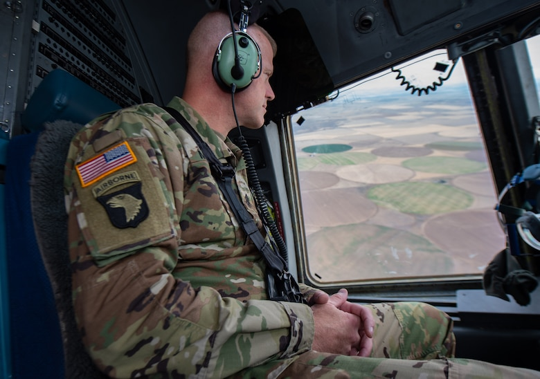 U.S. Army Command Sgt. Maj. Timothy Marble, Joint Base Lewis-McChord (JBLM) command sergeant major, looks out the window of a C-17 Globemaster III near Moses Lake Municipal Airport, Wash., Oct 1, 2019. The flight provided training opportunities for 7th Airlift Squadron pilots to practice a variety of aircraft landings for a mobility movement exercise. (U.S. Air Force photo by Senior Airman Tryphena Mayhugh)