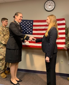 Dr. Janice McDaniel shakes hands with Lt. Col. Gwyneth Hughes after taking the Oath of Commissioned Officers. McDaniel commissioned as a major into the U.S. Army Reserve. Both McDaniel and Hughes work at Akron Children's Hospital.
