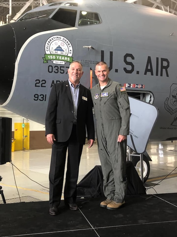 Randy White, Mayor of Derby and 931st Operations Group honorary commander, and Col. Phil Heseltine, 931st Air Refueling Wing commander pose in front of the KC-135 Stratotanker nose art dedicated to the city of Derby's 150th anniversary Oct. 2, 2019, at McConnell Air Force Base, Kan. The event promoted partnership between the local community and military members, while also honoring their long history together.