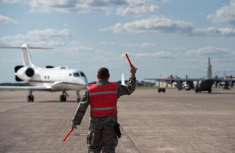 A U.S. Air Force Airman from the 133rd Aircraft Maintenance Squadron marshals U.S. Air Force Gen. Joseph L. Lengyel, chief, National Guard Bureau, aircraft into position in St. Paul, Minn., Aug. 21, 2019.