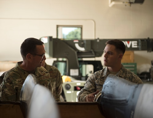 U.S. Air Force Airman 1st Class Zachary Monshaugen, 133rd Aircraft Maintenance Squadron, speaks to U.S. Air Force Gen. Joseph L. Lengyel, chief, National Guard Bureau,, in St. Paul, Minn., Aug. 21, 2019.