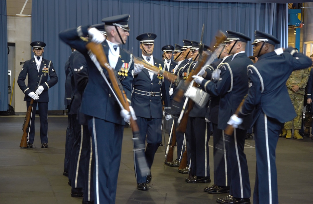 Members of the U. S. Air Force Honor Guard Firing Party conduct a drill requiring utmost precision during an immersion tour for Air Force District of Washington leadership Oct. 1.