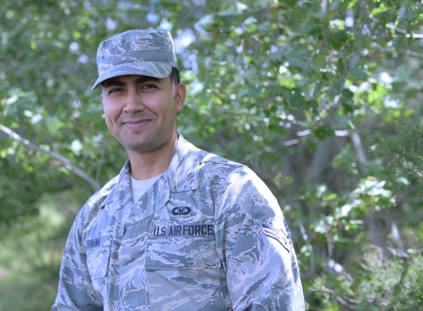 Airman in camouflage uniform poses for a casual portrait.