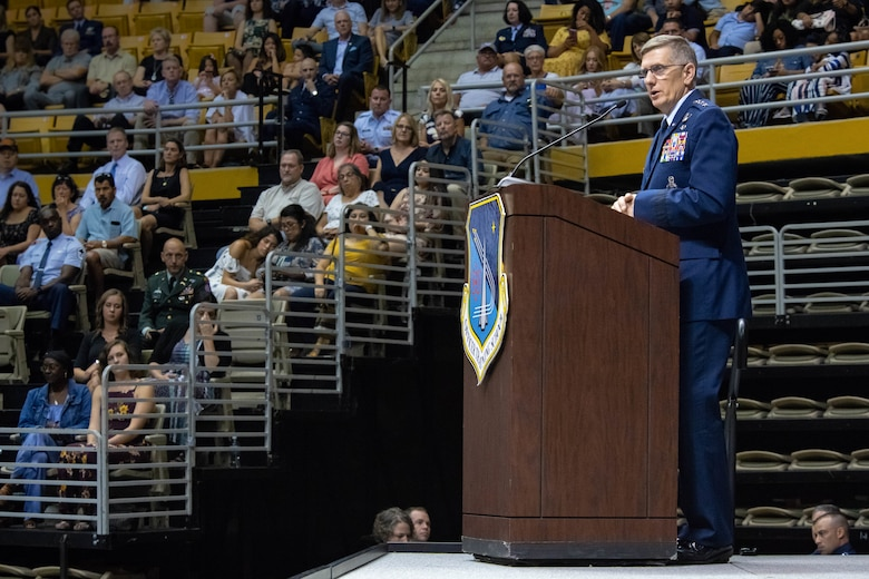 "Gen. Tim Ray, Air Force Global Strike Command commander, presents awards to newly commissioned officers from Air University's Officer Training School ""Godzilla"" class 19-07 during a ceremony at the Alabama State University Acadome, Montgomery, Ala., Sept. 26, 2019. The recipients earned these distinctions through their actions and dedication throughout the eight weeks of training."