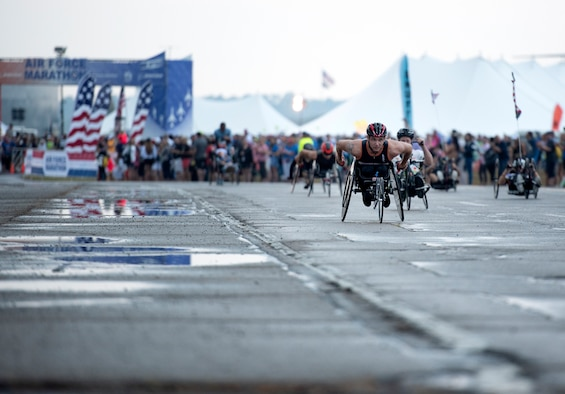 Wheeled race competitors take off from the start line at the Air Force Marathon on Sept. 21 at Wright-Patterson AFB, Ohio.  Brandon Hough, Air Force Marathon director plans to incorporate more inclusivity for athletes with disabilities at future marathons. (U.S. Air Force photo/Michelle Gigante)