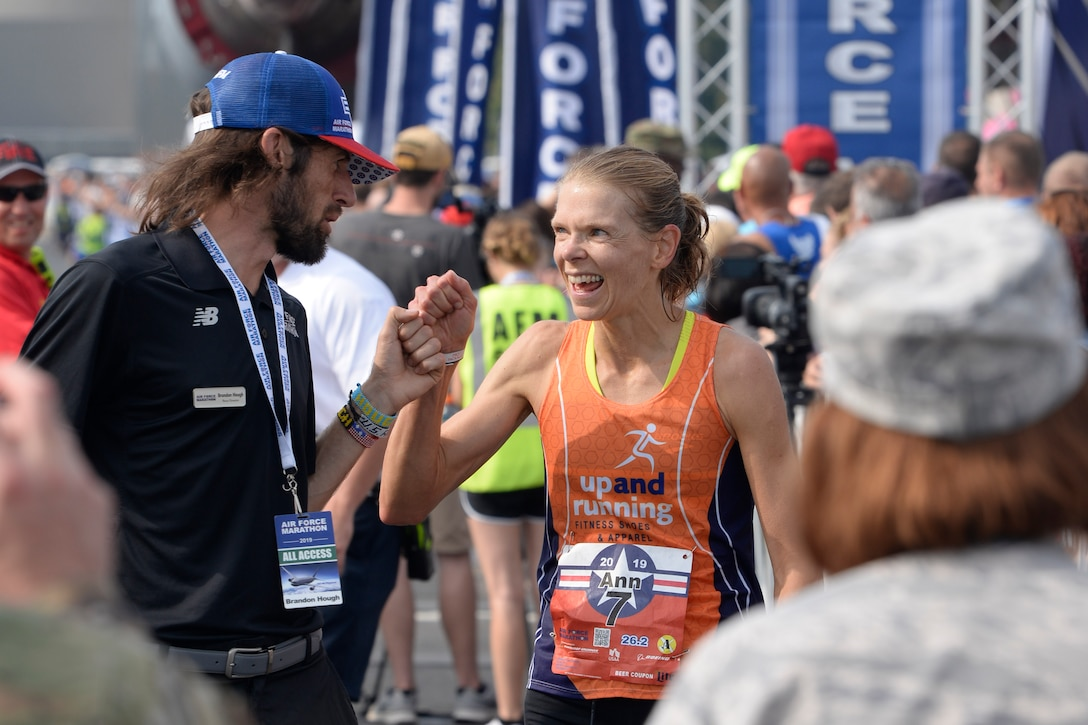 Brandon Hough, Air Force Marathon director, congratulates the full marathon female winner Ann Alyanak from Bellbrook, Ohio, at the Air Force Marathon at Wright-Patterson Air Force Base, Ohio, on Sept. 21. (U.S. Air Force photo/Ty Greenlees)