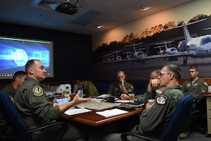 Maj. Gen. Wills, 19th Air Force commander, receives a briefing from members of the 48th Flying Training Squadron before a T-1 Jayhawk flight Oct. 2, 2019, on Columbus Air Force Base, Miss. One of the highlights of the visit for Wills was flying with the 48th Flying Training Squadron in the T-1 Jayhawk out of the Golden Triangle Regional Airport. (U.S. Air Force photo by Airman 1st Class Jake Jacobsen)