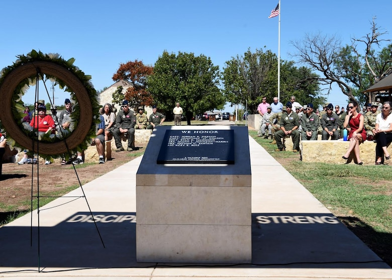 Family members and friends of fallen Airmen from TORQE 62 give a moment of silence at a memorial ceremony in Abilene, Texas, Oct. 2, 2019.