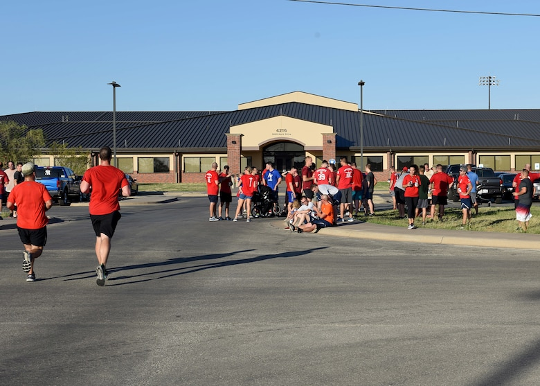 Airmen assigned to Dyess Air Force Base, Texas, finish their run in the TORQE 62 Memorial Run Oct. 2, 2019.