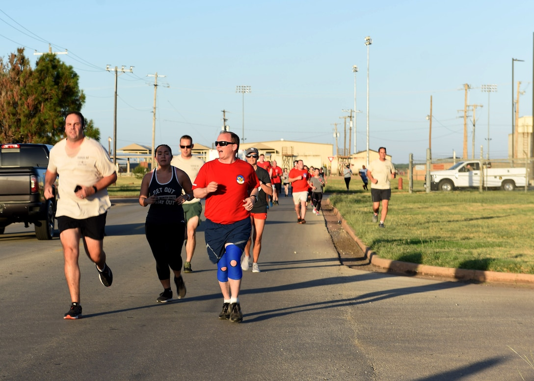 Airmen assigned to Dyess Air Force Base, Texas, participate in the TORQE 62 Memorial Run Oct. 2, 2019.