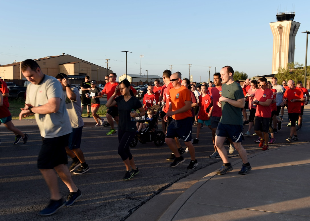 Airmen assigned to Dyess Air Force Base, Texas, start off the TORQE 62 Memorial Run Oct. 2, 2019.