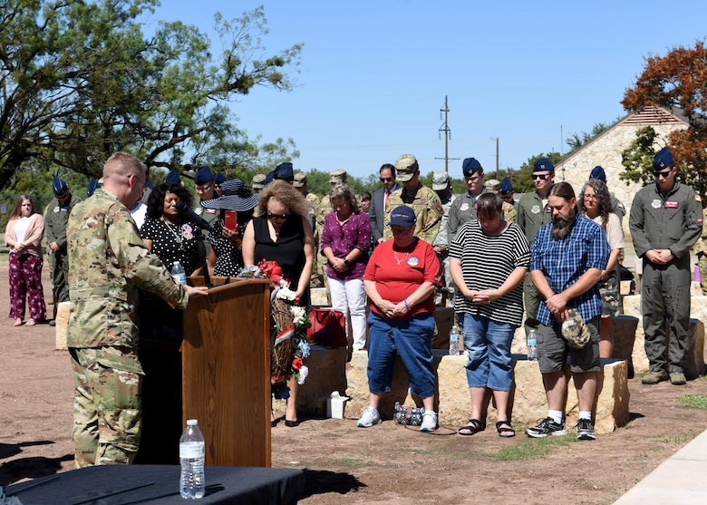 Maj. John Rollyson, 7th Bomb Wing chaplain, left, prays for the Airmen lost during TORQE 62 in Abilene, Texas, Oct. 2, 2019.