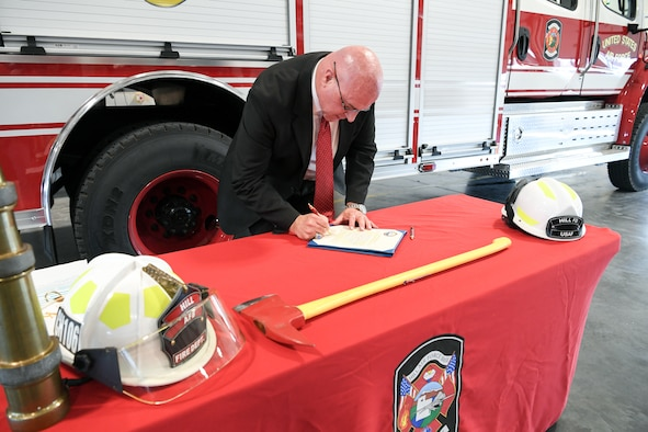 Harry Briesmaster, director for the 75th Civil Engineer Group, signs a proclamation Oct. 3, 2019, designating Oct. 6-12 Fire Prevention Week at Hill Air Force Base, Utah.