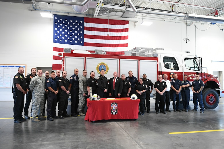 Firefighters and personnel from the 75th Civil Engineer Group gather for a group photo at the signing of a Fire Week Prevention proclamation signing Oct. 3, 2019, at Hill Air Force Base, Utah.