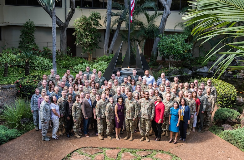Commanders, command chiefs, directors and spouses from across the Pacific Air Forces (PACAF) area of responsibility pose for a group photo at Headquarters PACAF, Joint Base Pearl Harbor-Hickam, Hawaii  during the fall commander's conference, Sept. 24 to 26.  The conference is designed to bring together senior leaders to discuss the many opportunities and challenges in the region as well as to discuss the progress on executing the command's strategy. (U.S. Air Force photo by Staff Sgt. Hailey Haux)