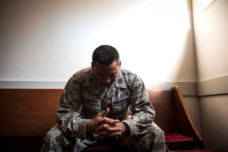 U.S. Air Force Capt. Genesis Guerrero, a 39th Air Base Wing chaplain, prays in the chapel at Incirlik Air Base, Turkey, Oct. 2, 2019. At a young age, Guerrero and his entire family fled from their home in Guam because his father's troubled lifestyle placed them all in danger. (U.S. Air Force photo by Staff. Sgt. Joshua Magbanua)
