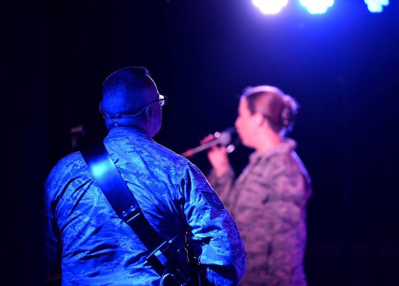 Tech. Sgt. Greg Lacy, U.S. Air Force Band of the West's Top Flight guitarist, strums his electric guitar during the Top Flight concert at the Columbus Riverwalk Stage Sept. 27, 2019, in Columbus, Miss. Like other ensembles within the U.S. Air Force Band of the West, Top Flight performs in support of official military gatherings, Air Force recruiting and community relations events. They provide a variety of music for dances, dinner shows and receptions. (U.S. Air Force photo by Airman 1st Class Hannah Bean)