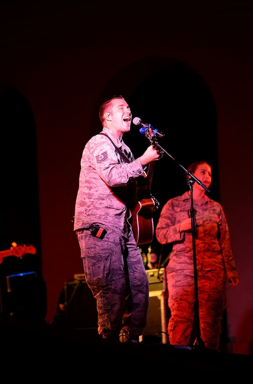 Tech. Sgt. Nick Daniels, U.S. Air Force Band of the West's Top Flight vocalist, sings while playing an acoustic guitar during the Top Flight concert at the Columbus Riverwalk Stage Sept. 27, 2019, in Columbus, Miss. Top Flight travels over 30,000 miles annually performing throughout Texas, Oklahoma, Louisiana, Mississippi, Alabama, Georgia, Florida, and Puerto Rico. (U.S. Air Force photo by Airman 1st Class Hannah Bean)