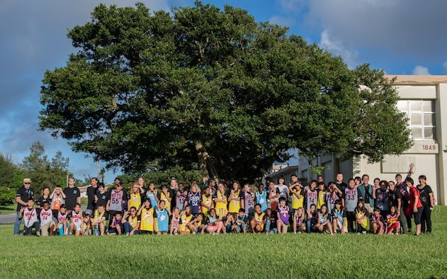 Children from Okinawa and the Kadena Youth Center pose for a photo during Cultural Exchange Day Sept. 28, 2019, at Kadena Air Base, Japan. The event enabled 49 children from Okinawa and the military community to play and interact with each other through a variety of both American and Japanese games and challenges. (U.S. Air Force photo by Staff Sgt. Micaiah Anthony)