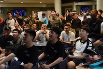 Airmen from the 8th Fighter Wing and 38th Fighter Group cheer on their teams during Friendship Day at Kunsan Air Base, Republic of Korea, Oct. 4, 2019. Friendship Day celebrates the partnership between the 8th FW and 38th FG, who participated in several sporting events and competitions throughout the day. (U.S. Air Force photo by Staff Sgt. Joshua Edwards)