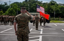 U.S. Marine Maj. Gen. William M. Jurney, Commanding General of 3rd Marine Division, renders a salute during the 12th Marine Regiment 92nd Anniversary Battle Colors Rededication Ceremony on Camp Hansen, Okinawa, Japan, Oct. 4, 2019. The ceremony is an opportunity for Marines to remember warriors past and to recognize contributions of service members and families to current operations. (U.S. Marine Corps photo by Lance Cpl. D'Angelo Yanez)