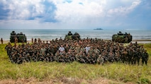 BLUE BEACH, Malaysia (Oct. 2, 2019) U.S. Marines and Sailors with 2nd Battalion, 2nd Marine Regiment, currently assigned to 3rd Marine Division, and members of the Malaysian Armed Forces (MAF), gather for a group photo after storming a beach during Tiger Strike 2019. Tiger Strike 19 focuses on strengthening joint military interoperability and on increasing readiness by practicing for humanitarian assistance, disaster relief, amphibious and jungle warfare operations, all while fostering cultural exchanges between the MAF and the U.S. Navy, Marine Corps team. (U.S. Marine Corps photo by Lance Cpl. Christine Phelps)