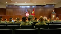 U.S. Marine Corps Brig. Gen. Mark A. Hashimoto, center, the commanding general of Force Headquarters Group, speaks to the audience during a relief and appointment ceremony at Marine Corps Support Facility New Orleans, Oct. 3, 2019. Sgt. Maj. Darby J. Noonan, center, the outgoing sergeant major of Force Headquarters Group, relinquished his duties as FHG sergeant major to Sgt. Maj. Michael S. Payne. Payne came to Marine Forces Reserve from his previous command of Staff Noncommissioned Officer Academy in Okinawa, Japan, where he served as the director. (U.S. Marine Corps photo by Sgt. Andy O. Martinez)