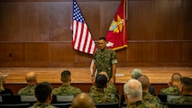 U.S. Marine Corps Sgt. Maj. Michael S. Payne, center, the incoming sergeant major of Force Headquarters Group, speaks to the audience during a relief and appointment ceremony at Marine Corps Support Facility New Orleans, Oct. 3, 2019. Sgt. Maj. Darby J. Noonan, the outgoing sergeant major of Force Headquarters Group, relinquished his duties as FHG sergeant major to Payne. Payne came to Marine Forces Reserve from his previous command of Staff Noncommissioned Officer Academy in Okinawa, Japan, where he served as the director. (U.S. Marine Corps photo by Sgt. Andy O. Martinez)