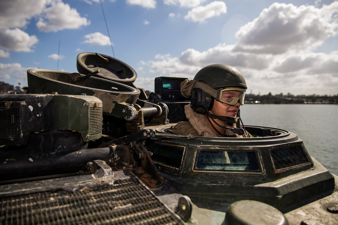 U.S. Marine Pfc. Wyatt Fender, a student with Assault Amphibian School Battalion, Training Command, conducts a communications check in an AAV-P7/A1 Amphibious Assault Vehicle prior to basic water and amphibious operations at the 21 Area boat basin on Marine Corps Base Camp Pendleton, California, Oct. 1, 2019. This training is meant to teach students basic amphibious operations like going to and from shore. The mission of the battalion is to teach Marines in Amphibious Assault Vehicle operations and maintenance while assisting in the development of formal training and logistical evaluations of new AAV systems. Fender is a native of Valdosta, Georgia.