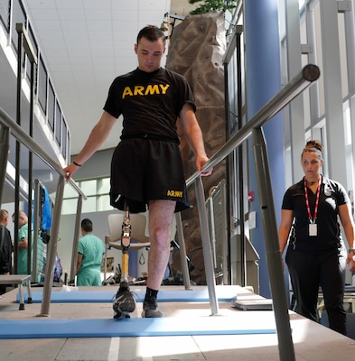 Candace Pellock, physical therapy assistant, guides with Spc. Ezra Maes at the Center for the Intrepid, Brooke Army Medical Center's cutting-edge rehabilitation center on Joint Base San Antonio-Fort Sam Houston, Oct. 2, 2019.