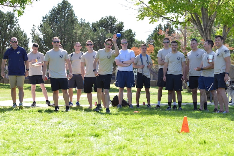 Members of the 71st Special Operations Squadron play bocce ball against 58th Special Operations Wing leadership during the 2019 58 SOW Sports Day at Kirtland Air Force Base, N.M., Sept. 27, 2019. Other sports played throughout the day included basketball, kickball, volleyball and more. The sports day included a competition between all the squadrons in the wing with top placements in every sport earning points for the unit. The 58th Aircraft Maintenance Squadron won the competition with almost double the points of the second place squadron.