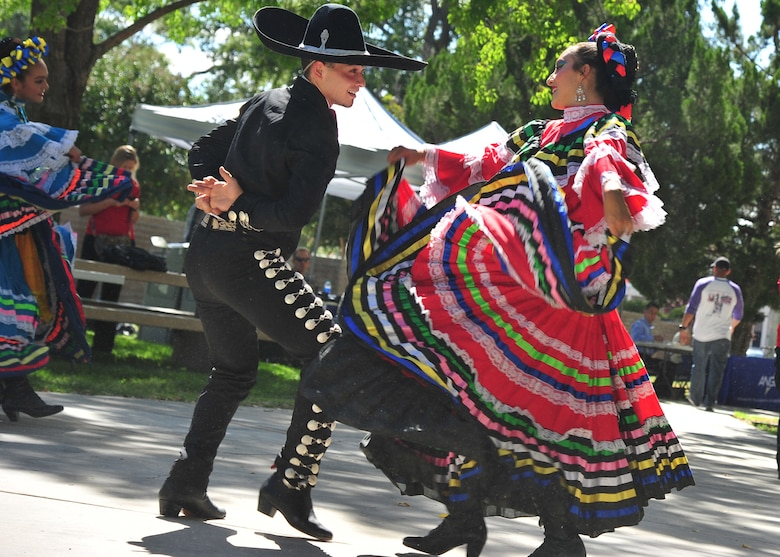 Dancers at the Hispanic Heritage Month festival perform a folkloric dance at Kirtland Air Force Base, N.M., Oct. 3, 2019. Hispanic Heritage Month is celebrated from Sept. 15 to Oct. 15 each year to recognize the contributions of Hispanic and Latino Americans to the country's history, heritage and culture. (U.S. Air Force photo by Airman 1st Class Ireland Summers)